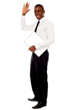 Handsome african businessman waving hand