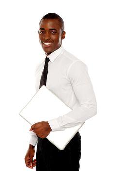 African businessman carrying laptop