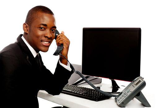 African businessman attending phone call