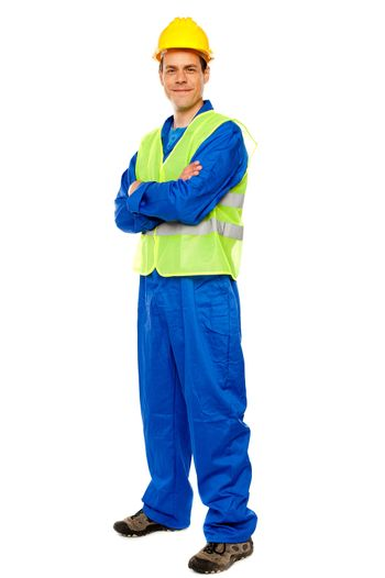 Handsome male repairman posing in style
