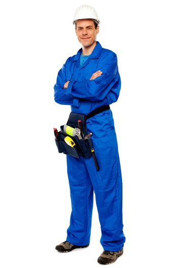 Industrial contractor posing with crossed arms