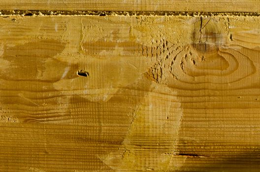 Wooden building wall plank closeup background details fragment.