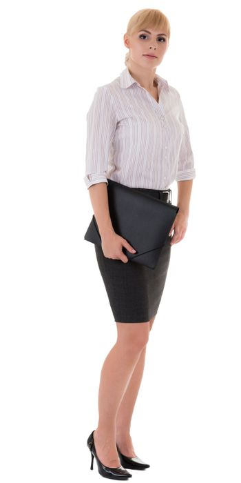 Full-length serious woman with folder