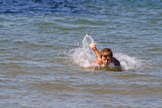 teenage boy in the sea