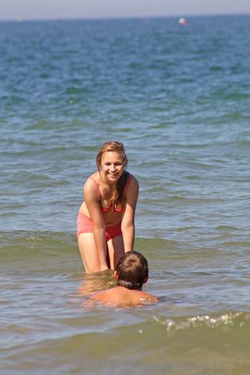 teenagers in the sea at cromer england