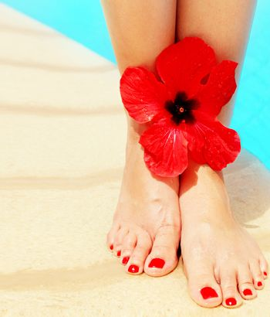 Beautiful female legs on the pool