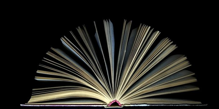 open book on black background
