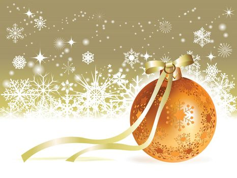Christmas ball with golden ribbon on snowy winter background