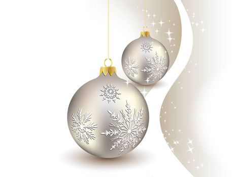 Christmas ball hanging on golden ribbon on snowy winter background