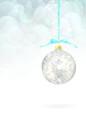 Christmas ball hanging on sky bule ribbon on snowy winter background