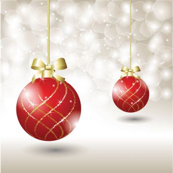Red Christmas ball hanging on golden ribbon on snowy winter background
