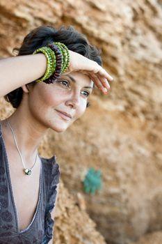 woman among rocks