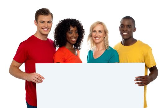 Group of youth displaying blank advertise board