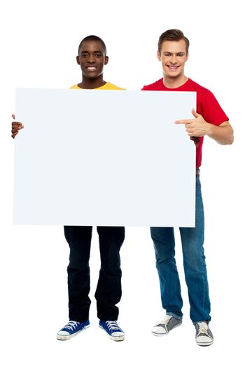 Smiling guys with white ad board
