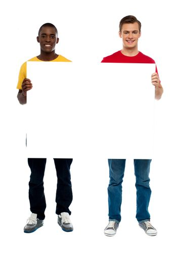 Trendy young guys presenting blank banner ad