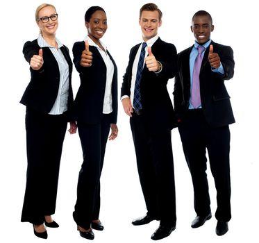 Corporate team gesturing thumbs up