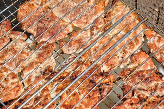 Cooking meat on charcoal