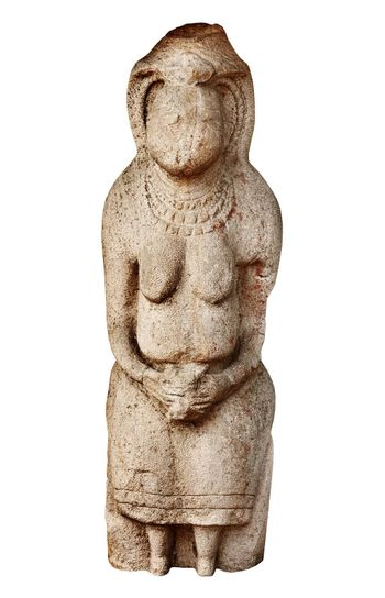 Pagan stone statue of VI century isolated on white