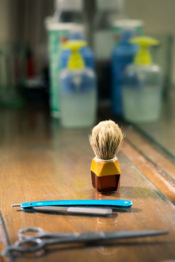 Close-up of brush and razor in barber shop