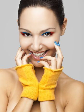 fashion portrait of a beautiful young woman smiling