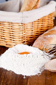 read, flour, eggs and kitchen utensil