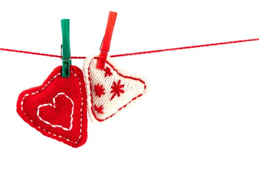 two knitted hearts on a red string