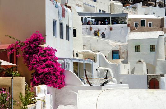 Amazing white houses of Santorini, Greece, terrace with hammock, sunny summer day