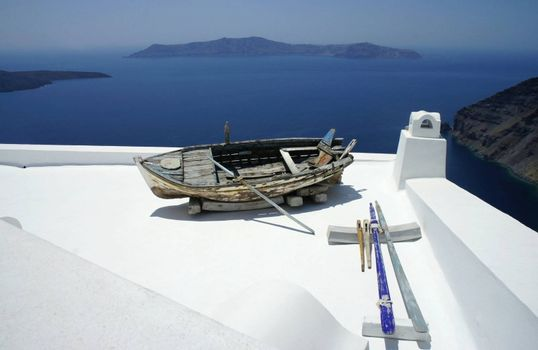 Santorini in details, composition with old ship