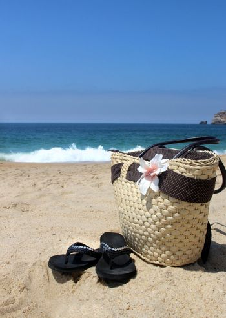 Seacoast, straw beach bag and flip-flops