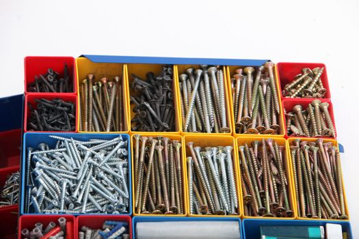 Toolbox with various new metal bolts and screws