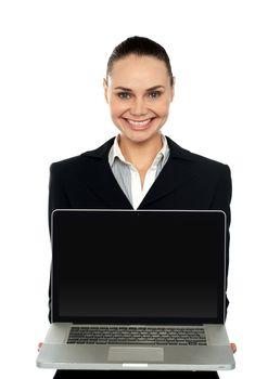 Female executive presenting brand new laptop