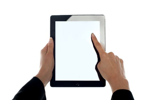 Closeup shot of female finger operating tablet