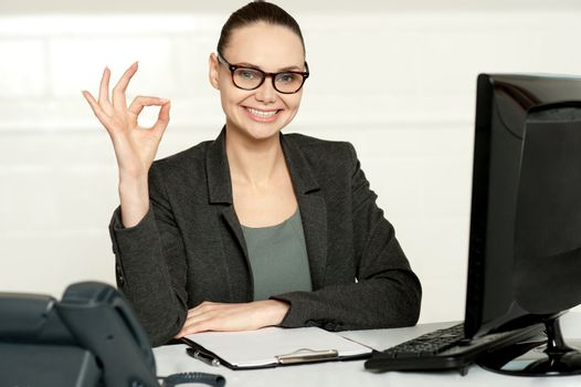 Corporate woman showing excellent gesture
