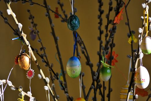 colorful easter tree with many brightly painted eggs on Easter palm kittens