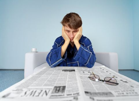Man with newspaper - hard find a job