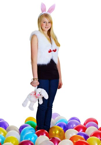 Young woman with a toy rabbit