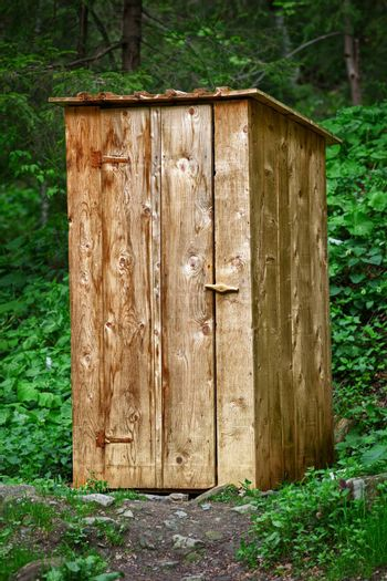 Rustic wooden toilet in the forest