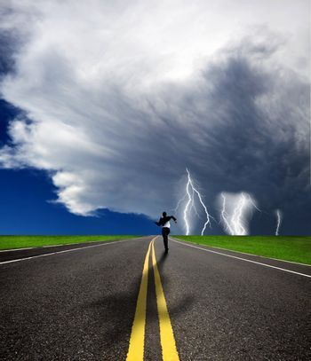 businessman running to the storm on the road