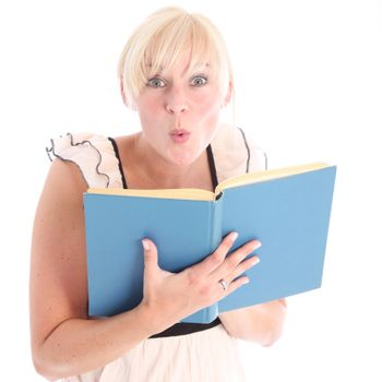 Excited blonde woman reading a blue book - isolated on white