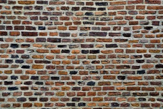 old parti-colored brick wall