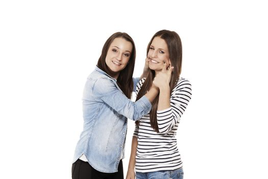 teenager forcing her friend to laugh