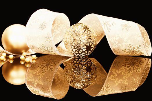 golden christmas balls with ribbon