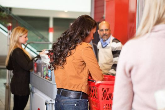 Customer with basket while shopping in supermarket