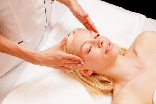 Woman Receiving Spa Massage