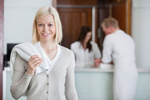 Pretty Caucasian woman with people in background at spa centre