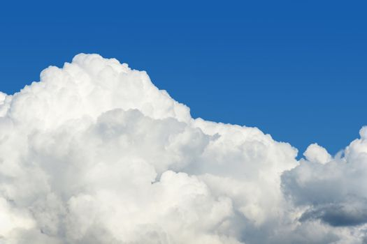 Cumulus puffly cloud and sky