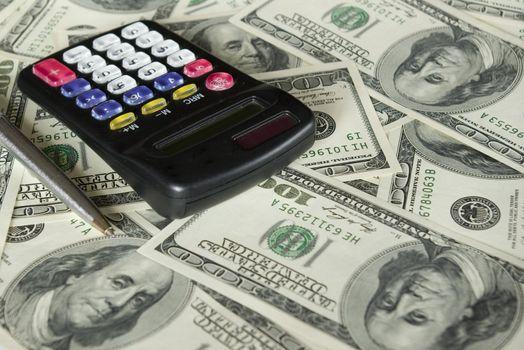 calculator and dollars