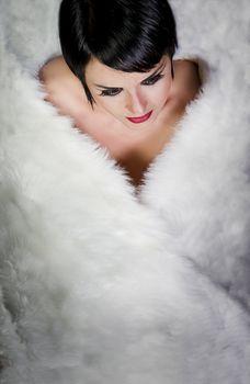 20s style beautiful brunette female wearing fur