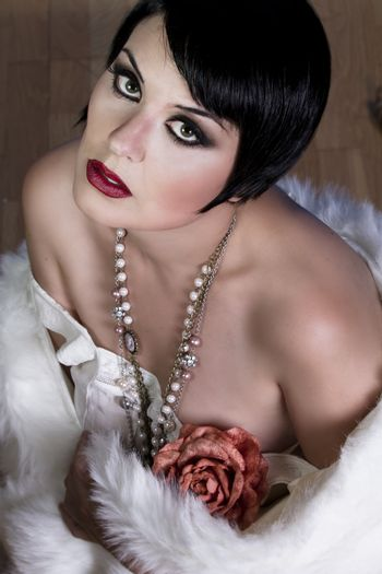 20s style beautiful brunette female wearing fur, exquisite