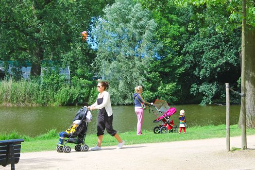 Mothers with children in city park in Amsterdam. Netherlands